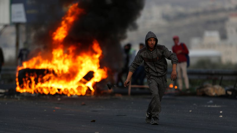Palestinians clash with Israeli troops in the wake of Donald Trump's decision on Jerusalem. Image via AP.