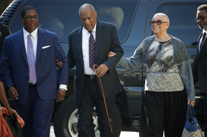 Bill Cosby, center; Camille Cosby, right (Matt Rourke/AP Images)