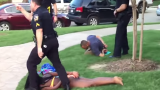 McKinney, Texas, Police Cpl. Eric Casebolt detains teenager Dajerria Becton and other teens at a pool party. YouTube Screenshot