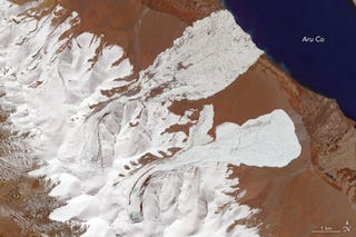 The Aru Glacier of western Tibet, as seen after two enormous ice slides on October 4th. Image: NASA Earth Observatory