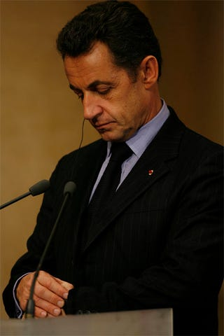 Illustration for article titled French Prez, Anxious To Get Back To Carla Bruni, Checks Watch