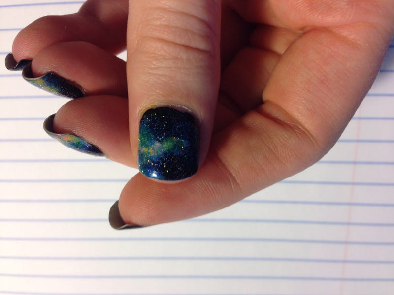 Illustration for article titled Check out my galaxy nails!