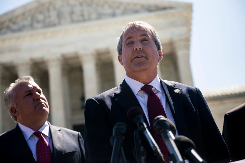 Texas Attorney General Ken Paxton speaks to reporters at a news conference outside the Supreme Court on Capitol Hill on June 9, 2016 in Washington, D.C. Paxton announced a lawsuit against the state of Delaware over unclaimed checks.