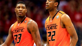 Marcus Smart (left) and teammate Markel Brown during a game against the Kansas Jayhawks on Jan. 18, 2014, in Lawrence, Kansas.Jamie Squire/Getty Images