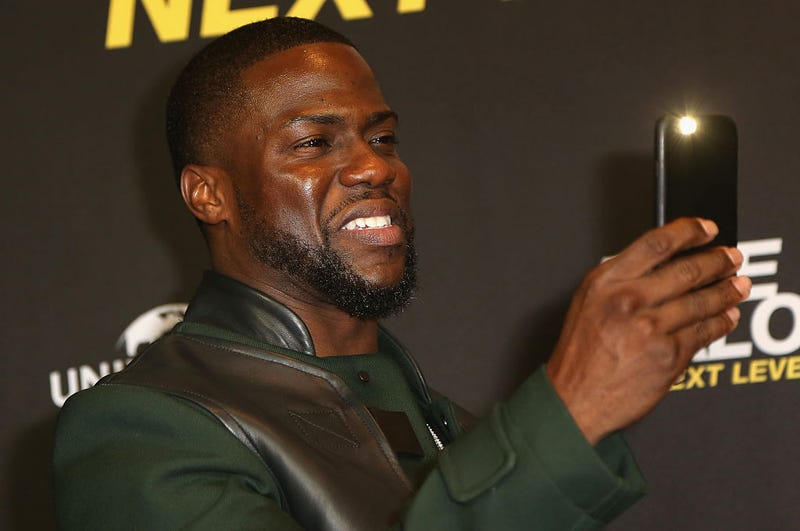 Kevin Hart takes pictures with his mobile phone during a photo call for the film Ride Along: Next Level Miami on Jan. 18, 2016, in Berlin.Adam Berry/Getty Image