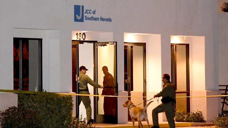 Las Vegas Metropolitan Police Department K-9 officers search the Jewish Community Center of Southern Nevada after an employee received a suspicious phone call that led about 10 people to evacuate the building on February 27, 2017 in Las Vegas, Nevada. Image via Getty.