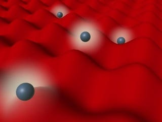 Illustration for article titled The world's smallest mirror reflects and traps individual atoms