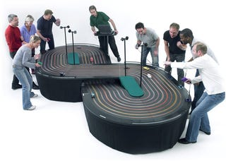 Illustration for article titled 8 Lane Scalextric Slot Racer Track: The Ultimate Team Building Gadget
