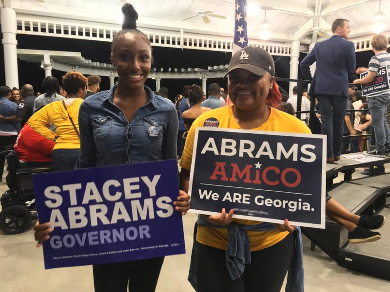 Paris Carter, left and Kelsy Brown, right, are students at Savannah State University and have been canvassing for Stacey Abrams.