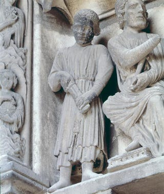 The Judgment of Solomon, circa 1220. Stone lintel relief.North transept, west portal,Chartres Cathedral, France