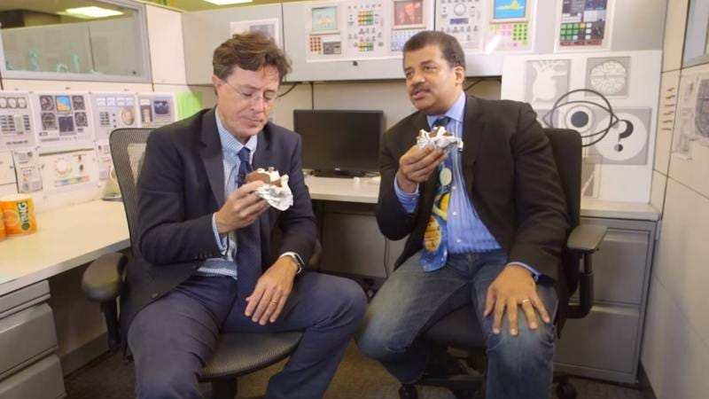 Illustration for article titled Stephen Colbert schools Neil deGrasse Tyson on Pluto facts