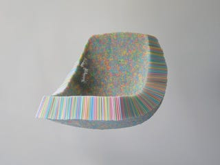 Illustration for article titled A Chair Made From 10,000 Drinking Straws