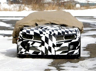 Illustration for article titled Firebird And Ice! Camo-Covered Trans Am Camaro Conversion Caught In Snow