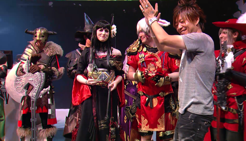 "Yoshida (right) asks Yotsuyu cosplayer (in black) to ""step on me, please."""