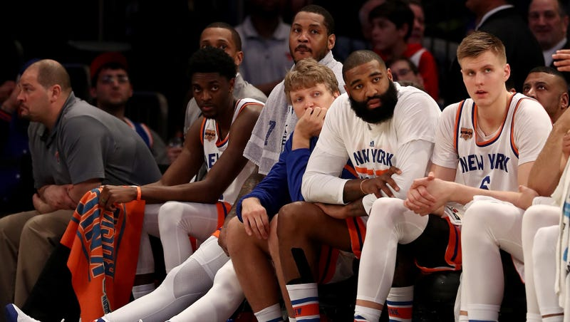 Four Hall of Famers, and Carmelo Anthony, on the Knicks bench. Photo credit: Elsa/Getty