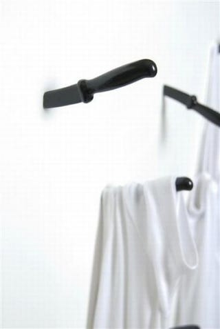 Illustration for article titled Knife Hooks Bring Ultraviolence to the Coat Rack