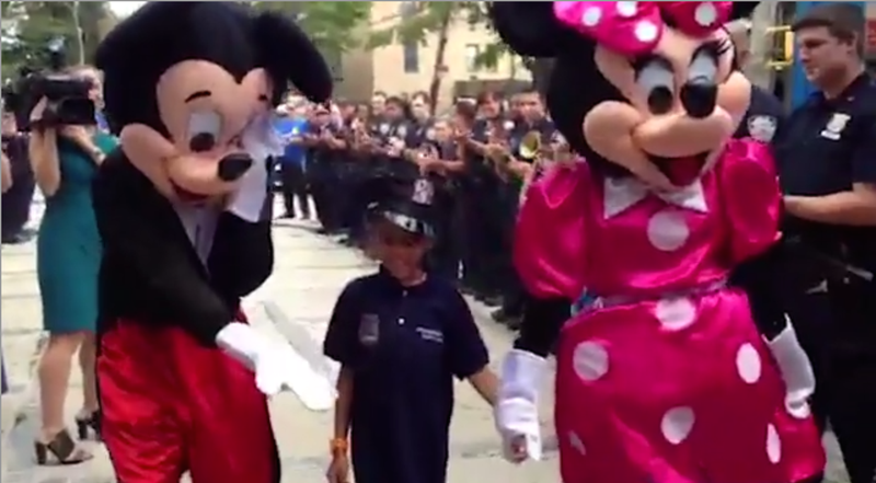 Tyrone Lowe Jr. walks to the 49th Precinct station house in the Bronx, N.Y., hand in hand with Mickey and Minnie Mouse.New York Post Video Screenshot