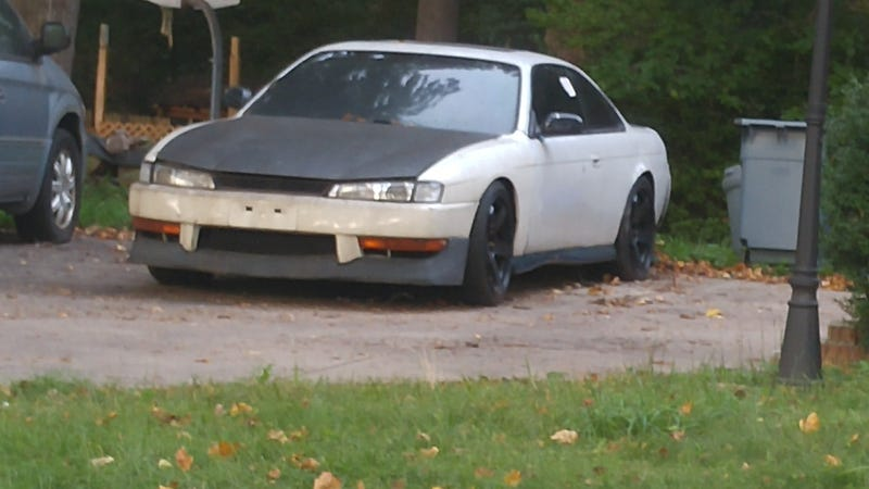 Illustration for article titled My neighbor is letting this S14 sit and rot
