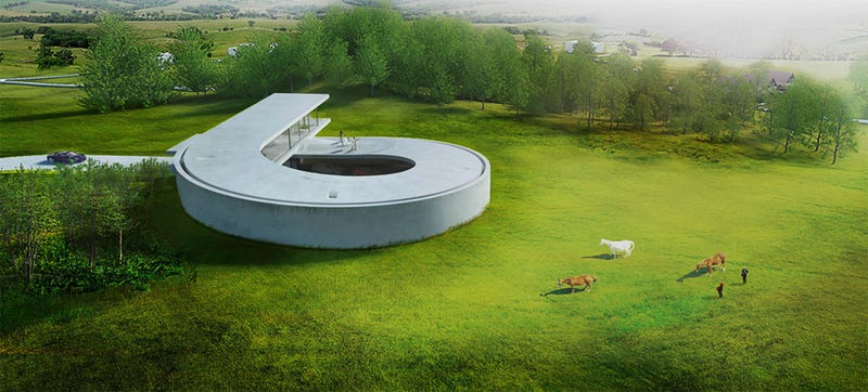 Illustration for article titled This Massive Concrete Loop Is Part House, Part Car Gallery
