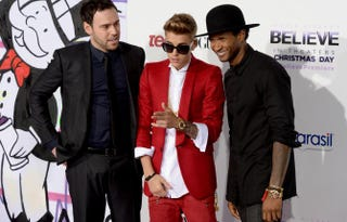 Producer Scooter Braun, Justin Bieber and Usher on Dec. 18, 2013, in Los AngelesJason Kempin/Getty Images