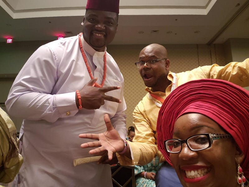 Faux Nigerian Jason Johnson, center, with actual Nigerians Obinna Nwokike, left, and Nkechi Nneji.