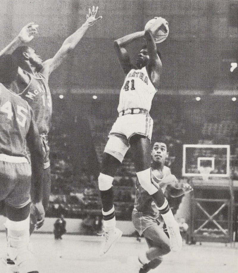 DeMatha's James Brown shooting over future NBA vet Tim Bassett of rival McKinley Tech in 1969 game.