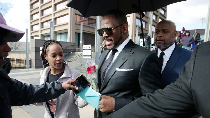 Fans giving singer R. Kelly a rose, and cards, outside the Leighton Courthouse on March 22, 2019 in Chicago, Illinois.