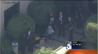Image of Chris Brown chatting with his lawyer via screengrab/KTLA