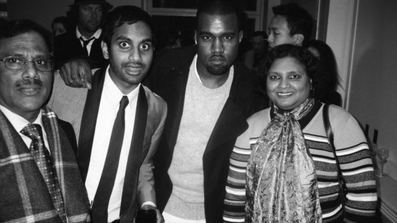 Illustration for article titled This photo of Kanye West with Aziz Ansari's parents is fantastic