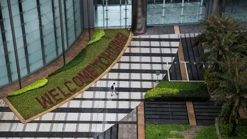 A garden with 'Welcome to Huawei' spelled out in flowers is seen outside an office building at the company's Bantian campus on April 12, 2019 in Shenzhen, China
