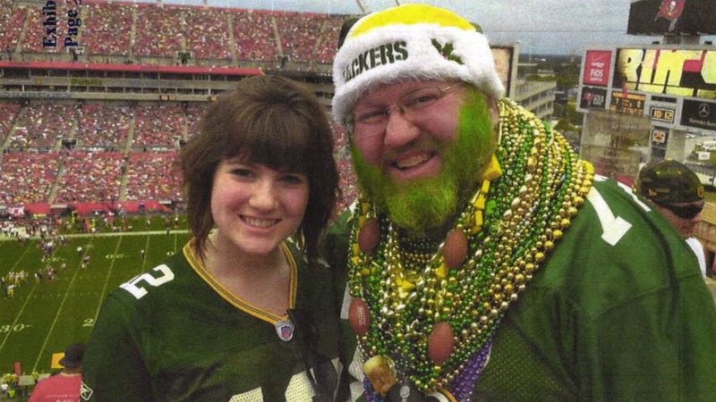 Packers fan Russell Beckman has sued the Bears for not letting him on the field in his Packers gear last season, even though he'd earned the perk as a Bears season ticket-holder. He is shown here with his daughter at a Buccaneers game, in an image submitted as part of the lawsuit.
