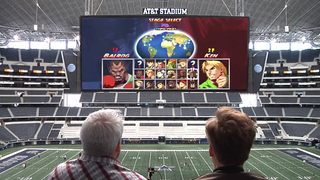 Illustration for article titled Conan O'Brien Takes Over A Football Stadium's Screen With Video Games