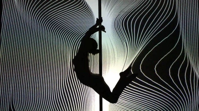 Illustration for article titled Watch This Pole Dancer's Gorgeous Interactive Routine with Geometric Light