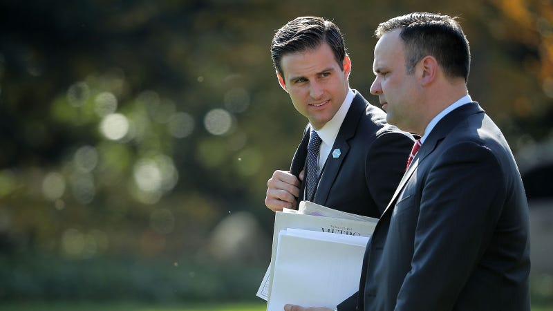 White House Personal Aide to the President John McEntee (L) and White House Director of Social Media Dan Scavino leave the White House with U.S. President Donald Trump November 29, 2017 in Washington, DC.