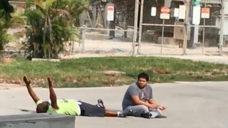 Charles Kinsey, shown on the ground with his hands up, was shot by a North Miami police officer.NBC News Screenshot