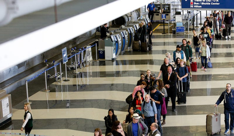 90-minute waits at O'Hare yesterday. AP Photo/Teresa Crawford
