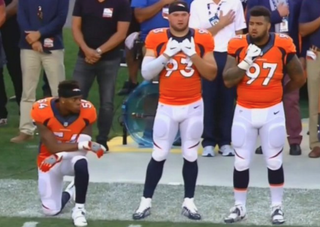 Denver Broncos linebacker Brandon Marshall kneels during the national anthem during an NFL game as a protest against racial injustice in the nation.WTVR Screenshot