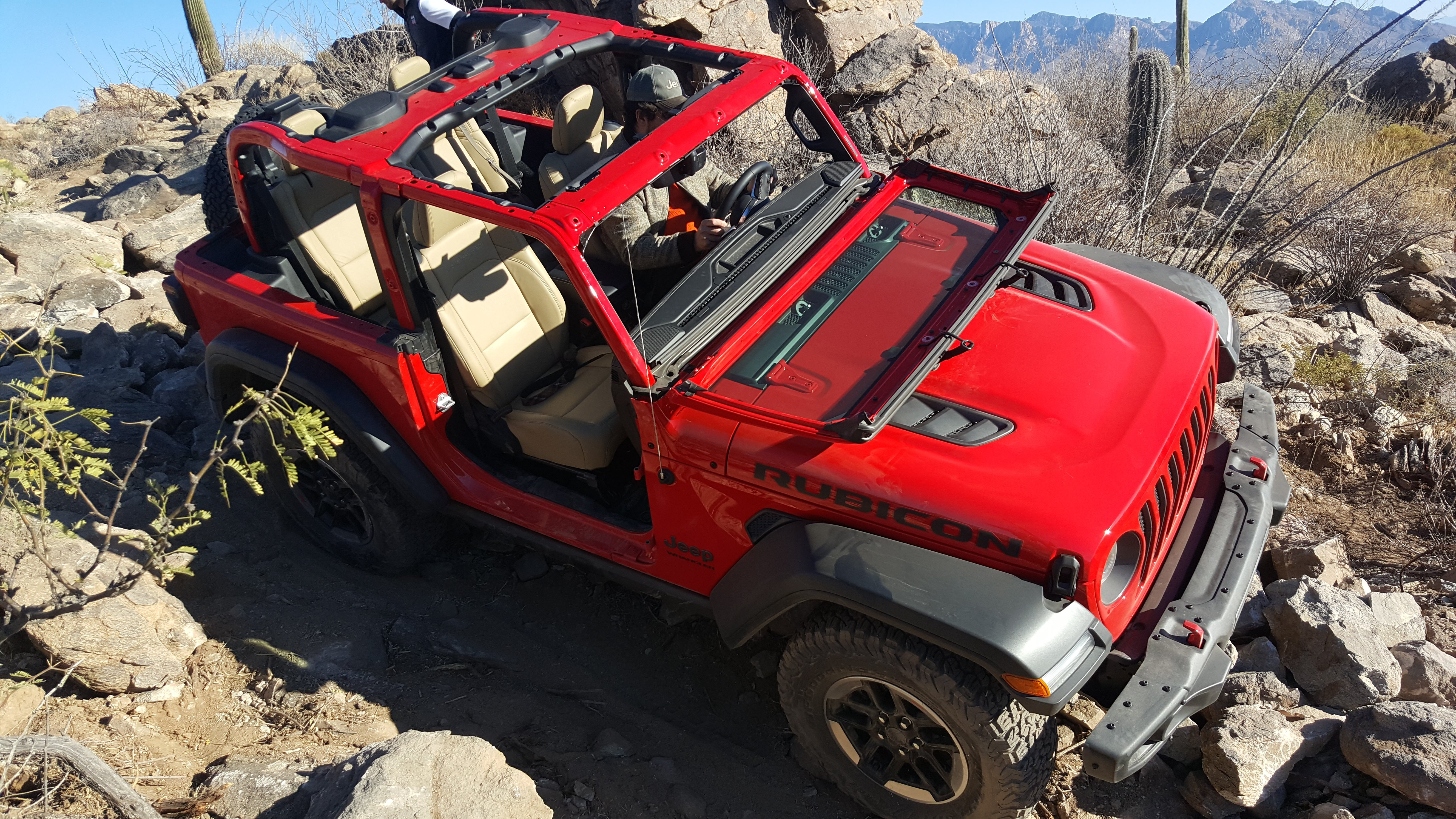 Driving around topless with no doors and the windshield folded down is a pastime that connects Jeep Wrangler owners with those who putted around in the very ... & Your Guide To Taking The Doors And More Off The 2018 Jeep Wrangler
