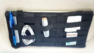Illustration for article titled Mount a Grid Organizer in Your Car to Keep Important Stuff at Hand