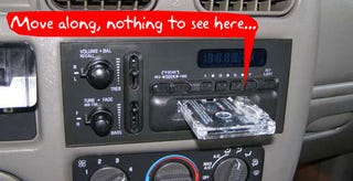 Illustration for article titled Hide Your Fancy Car Stereo Behind a Very Crappy Car Stereo