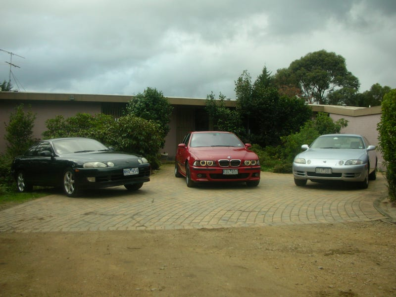 Illustration for article titled I'm glad to be back.....Here, have a photo of my garage circa 2009 to celebrate. I miss that M5....