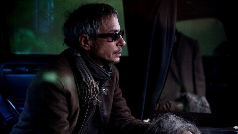 Leos Carax on the set of Holy Motors (Photo: Benoît Bouthors)