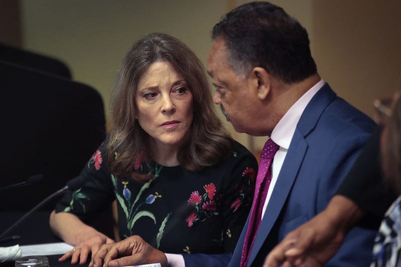 Rev. Jesse Jackson speaks with Democratic presidential candidate and self-help author Marianne Williamson at the Rainbow PUSH Coalition Annual International Convention on July 1, 2019, in Chicago.