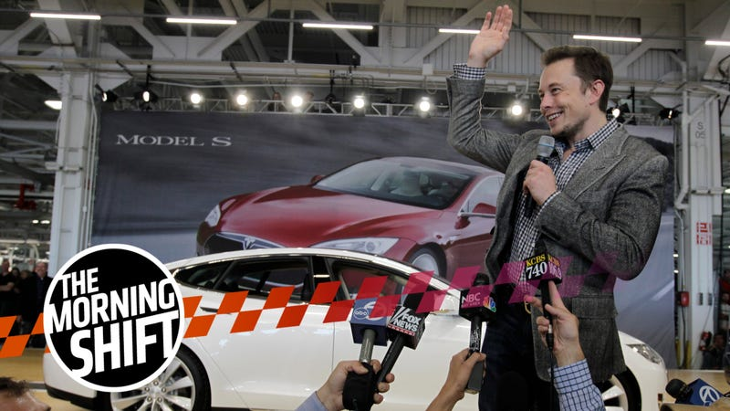 Tesla CEO Elon Musk waves during a rally at the Tesla factory in Fremont, Calif., Friday, June 22, 2012.