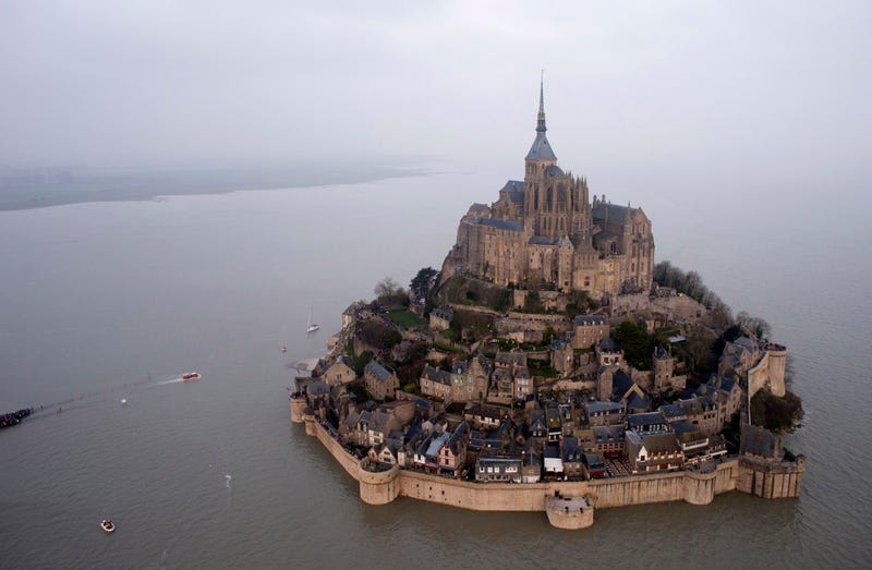 """Illustration for article titled """"Supertide"""" Creates Dramatic Temporary Island Off The Coast Of France"""