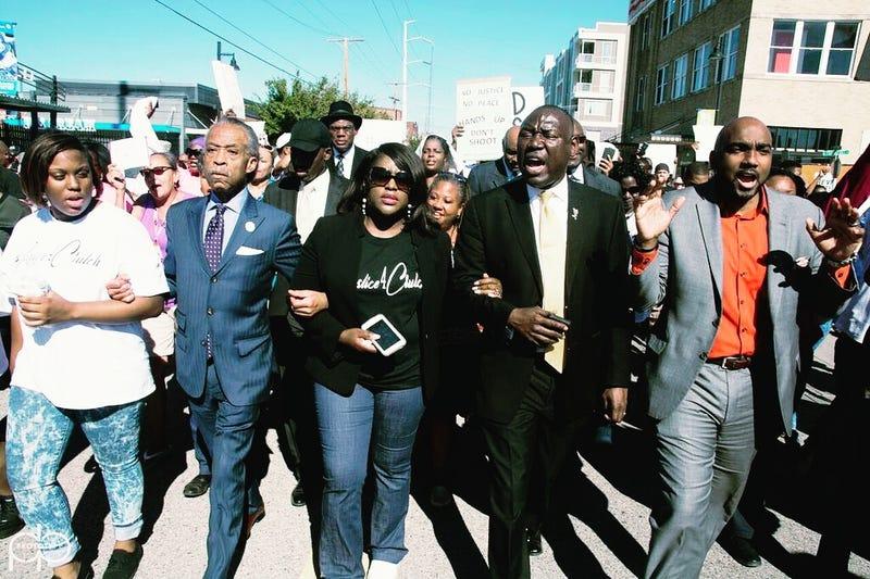Tiffany Crutcher (center) marches alongside Rev. Al Sharpton demanding justice for her brother Terence Crutcher's death