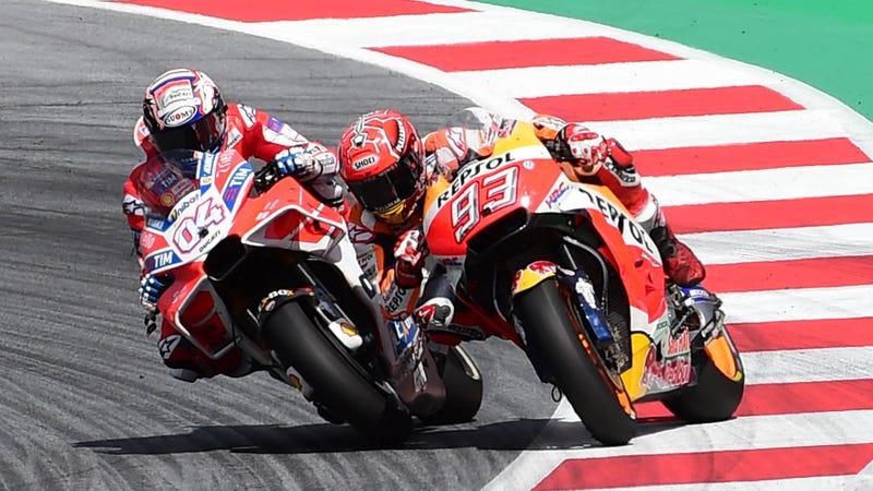 Last corner shenanigans between Ducati's Andrea Dovizioso, left, and Repsol Honda's Marc Marquez.