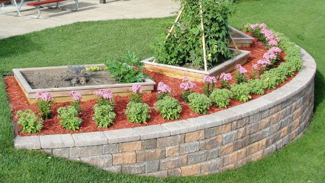 Build a block retaining wall to beautify a steep slope for Landscape blocks