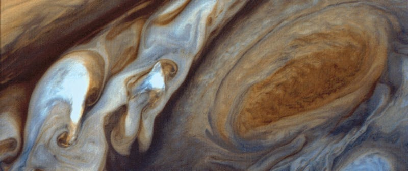 Illustration for article titled Jupiter's Great Red Spot Looking Like a Swirl of Cream in Your Coffee
