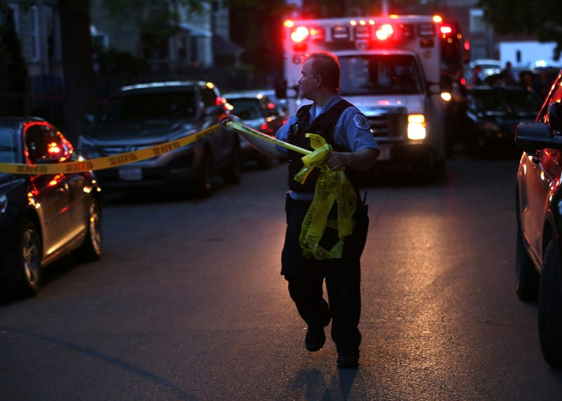 Police expand the crime scene in the 3900 block of West Lexington Street, where a 20-year-old woman suffered a gunshot wound to the head, in Chicago on May 28, 2016.E. Jason Wambsgans/Chicago Tribune/TNS via Getty Images